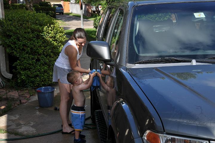 Jackson & E washing the car