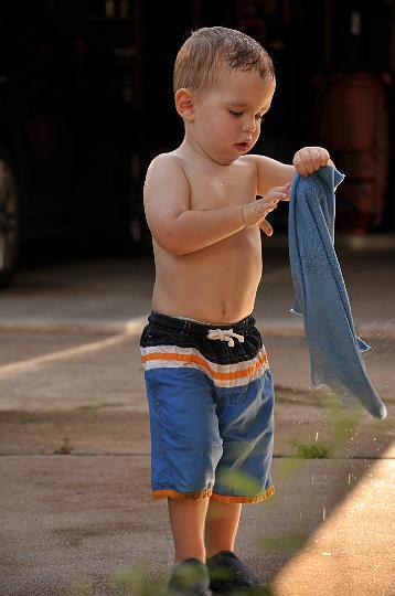 Jackson washing the car