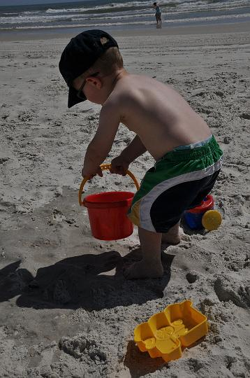 Jackson pouring water on the sand